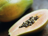 Papaya (Pawpaw) Sliced Open to Show Black Seeds