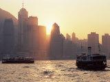 Star Ferries  Victoria Harbour and Hong Kong Island Skyline at Sunset  Hong Kong  China  Asia