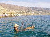 Woman Floating in the Dead Sea Reading a Magazine  Aqaba  Jordan