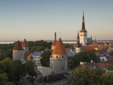 Medieval Town Walls and Spire of St Olavs Church at Dusk  Tallinn  Estonia  Baltic States  Europe