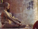 Hindu Pilgrim Meditating  Sitting Cross-Legged on the Ghats  Varanasi  Uttar Pradesh State  India