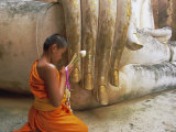 Novice Buddhist Monk and Phra Atchana Buddha Statue  Sukhothai Province  Thailand