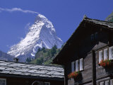 The Peak of the Matterhorn Mountain Towering Above Chalet Rooftops  Swiss Alps  Switzerland