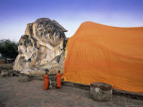 Two Novice Buddhist Monks in Front of a Statue of the Reclining Buddha  Central Thailand  Thailand