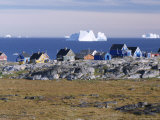 Painted Village Houses in Front of Icebergs in Disko Bay  West Coast  Greenland