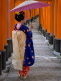Portrait of a Geisha Holding an Ornate Umbrella at Fushimi-Inari Taisha Shrine  Honshu  Japan