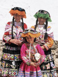 Portrait of Three Local Peruvian Girls in Traditional Dress  Looking at the Camera  Cuzco  Peru