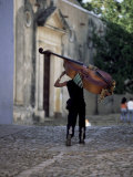 Musician Carrying Double Bass Along Cobbled Street to Plaza Mayor  Trinidad  Cuba