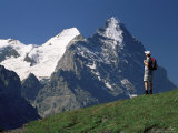 Hiker Looking to the Snow-Covered Monch and the North Face of the Eiger  Swiss Alps  Switzerland