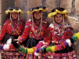 Portrait of Three Smiling Local Peruvian Girls in Traditional Dance Dress  Peru