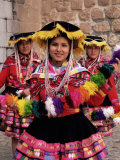 Portrait of Three Local Peruvian Girls in Traditional Dance Dress  Peru