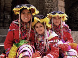 Portrait of Three Smiling Peruvian Girls in Traditional Dance Dress  Peru