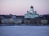 Dusk Light on Lutheran Christian Cathedral in Winter Snow  Across the Frozen Baltic Sea  Finland