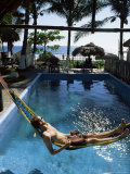 Tourist in Hammock Relaxing Over Pool  Monterico  Guatemala  Central America