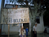 Semuc Champey Sign in Town of Coban  with Local Kids  Guatemala  Central America