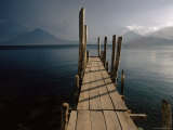 Wooden Jetty and Volcanoes in the Distance  Lago Atitlan (Lake Atitlan)  Guatemala  Central America