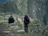 Backpackers Look at the Inca Ruins at Machu Picchu  Unesco World Heritage Site  Peru  South America