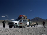 Landcruisers and Tourists on Jeep Tour Taking a Break on Uyuni Salt Flat  Bolivia  South America