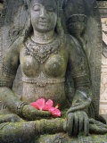 Statue with Flower Offering  Odalan  Ceremony  at Bataun Temple  Bali  Indonesia  Asia