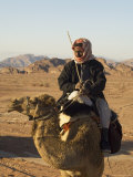 Bedouin on Camel in the Desert  Wadi Rum  Jordan  Middle East
