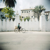 Man on Bicycle with Old Buildings Behind  Stone Town  Zanzibar  Tanzania  East Africa  Africa
