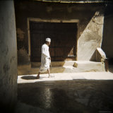 Old Man Walking Down Shady Street in Traditional White Robes  Stone Town  Zanzibar  Tanzania
