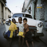 Three Young Boys Posing Against Old White American Car  Havana  Cuba  West Indies  Central America