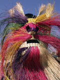 Head and Shoulders Portrait of a Person Wearing a Brightly Coloured Straw Mask  North America