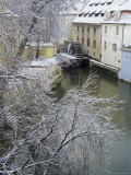 Snow-Covered Certovka Canal and Water Wheel at Kampa Island  Czech Republic  Europe