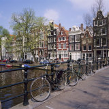 Bicycles on a Bridge Across the Canal at Herengracht in Amsterdam  Holland
