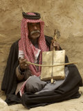 Bedouin Man in Traditional Dress Playing a Musical Instrument  Beida  Jordan  Middle East