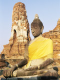 Sitting Buddha Statue and Chedi at Buddhist Temple of Wat Phra Mahathat  Thailand  Southeast Asia