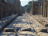 Ancient Roman Street with Chariot Ruts and Stepping Stones in Pompeii  Italy