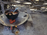 Beans and Tomoatoes Cook over a Fiel  Yucatan  Mexico