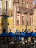 Balconies on Painted Houses Overlooking Tables with Umbrellas  Guanajuato  Mexico