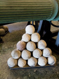 Cannon Balls Stacked Next to the Barrel of a Cannon at the Arsenale  Venice  Italy