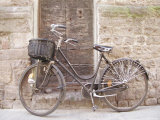 Bicycle Leaning against a Stone Wall in Parma  Italy