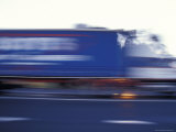 Blurred Speeding Semitrailer Truck Races Along the Highway  Australia