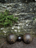 Cannon Balls at the Base of a Stone Wall at Brolio Castle  Tuscany  Italy