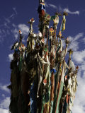 Cluster of Tibetan Prayer Flags against a Blue Sky with Clouds  Qinghai  China