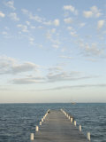 Ambergris Caye Pier in the Afternoon  Clouds and Boat near San Pedro  Belize