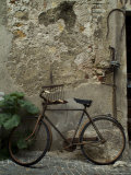 Antique Rusted Bicycle Leans against a Stone Wall  Asolo  Italy