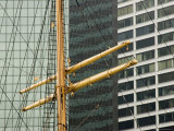 Buildings Behind the Mast of a Sailing Ship at South Street Seaport  New York  New York