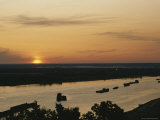 Barges Silhouetted on the Volga River at Dawn