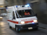 Early Morning Ambulance Speeds by for Rescue Operation  Florence  Italy