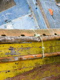Colorful  Weather Beaten Boat Deteriorates on Chilean Shore