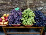 Grapes and Nectarines on a Bench at a Siena Market  Tuscany  Italy
