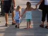 Grandchildren Walk Down a Wooden Pier with their Grandparents