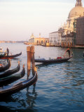Gondoliers on the Grand Canal at Sunset  Venice  Italy