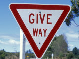 Give Way Sign on the Side of the Road